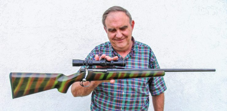 Melvin Forbes with the rifle that changed his life, altered rifle history and that was a hit at the 1985 SHOT Show.
